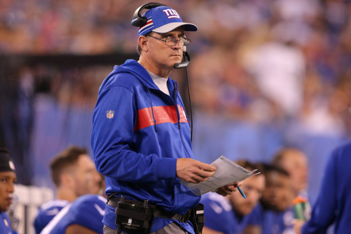 New York Giants offensive coordinator Mike Shula coaches against the New Orleans Saints during the fourth quarter at MetLife Stadium.