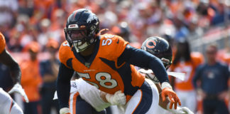Denver Broncos outside linebacker Von Miller (58) pass rushes on the Chicago Bears in the first quarter at Empower Field at Mile High.