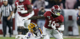 LSU Tigers cornerback Jay Ward (16) tries to bring down Alabama Crimson Tide wide receiver Henry Ruggs III (11) after a reception during the second half of an NCAA college football game at Bryant-Denny Stadium