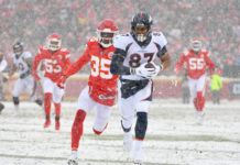 Denver Broncos tight end Noah Fant (87) runs the ball as Kansas City Chiefs cornerback Charvarius Ward (35) defends during the first half at Arrowhead Stadium.