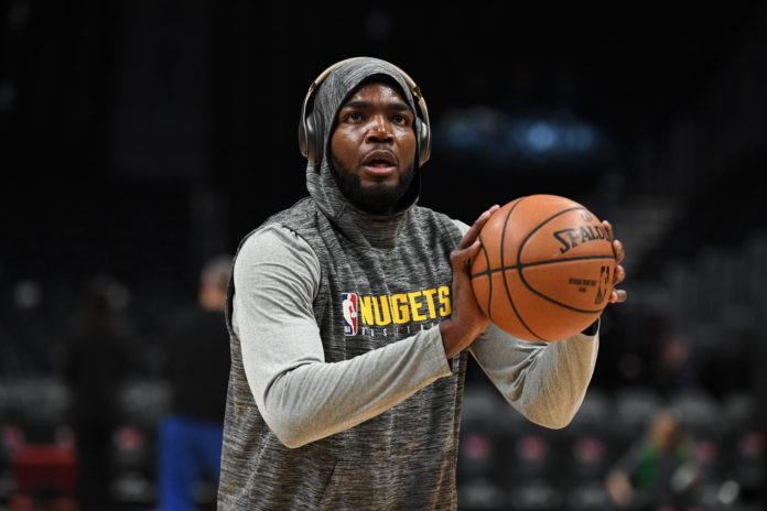 Denver Nuggets forward Paul Millsap (4) warms up before a game Orlando Magic at the Pepsi Center.