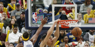 Denver Nuggets forward Michael Porter Jr. (1) dunks the ball against Indiana Pacers center Myles Turner (33) during the third quarter at Bankers Life Fieldhouse.