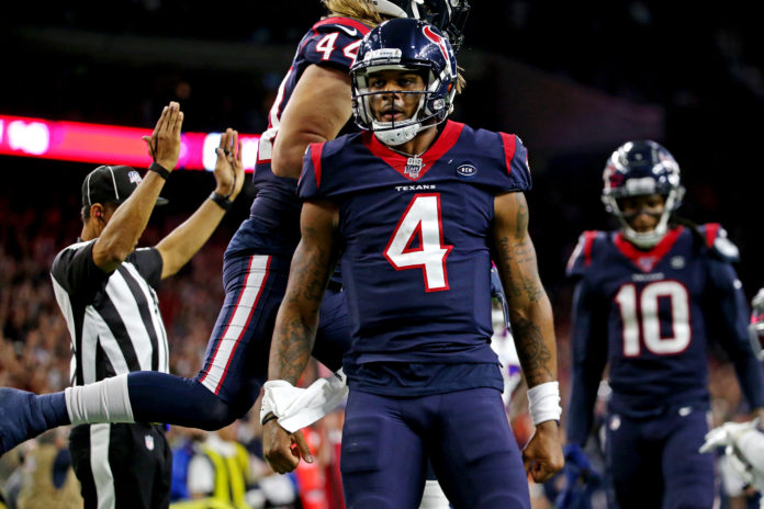 Houston Texans quarterback Deshaun Watson (4) celebrate after scoring a touchdown during the third quarter against the Buffalo Bills in the AFC Wild Card NFL Playoff game at NRG Stadium.