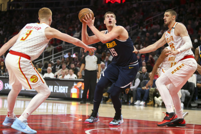 Denver Nuggets center Nikola Jokic (15) shoots against the Atlanta Hawks in the first half at State Farm Arena.