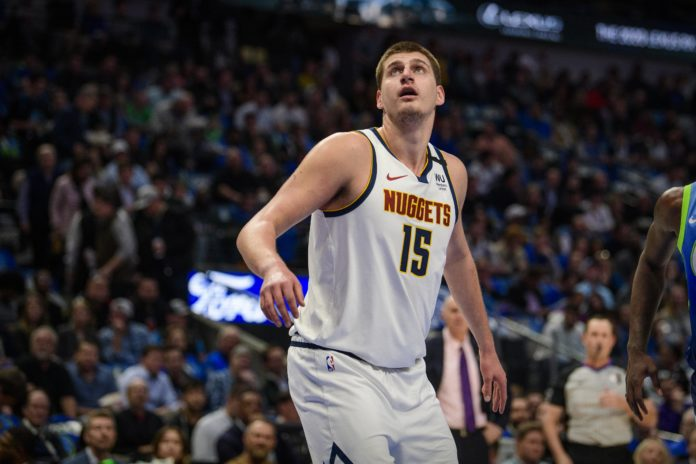 Denver Nuggets center Nikola Jokic (15) looks for the ball during the first quarter against the Dallas Mavericks at the American Airlines Center.