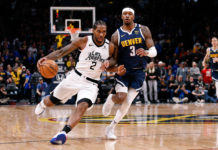 Los Angeles Clippers forward Kawhi Leonard (2) drives to the net against Denver Nuggets forward Torrey Craig (3) in the fourth quarter at the Pepsi Center.