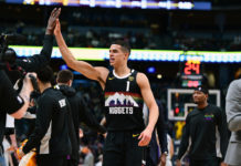 Denver Nuggets forward Michael Porter Jr. (1) celebrates his score in the second quarter against the Charlotte Hornets at the Pepsi Center.