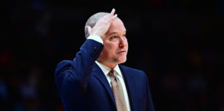 Denver Nuggets head coach Michael Malone wipes his head during the second half against the Charlotte Hornets at the Pepsi Center.