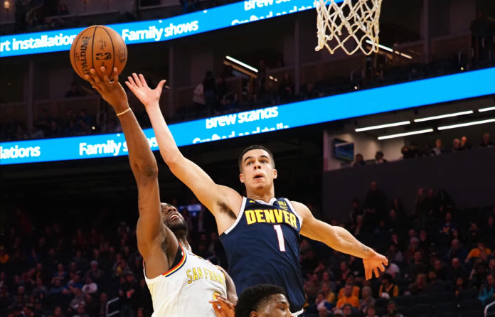 Denver Nuggets forward Michael Porter Jr. (1) defends the shot by Golden State Warriors guard Alec Burks (8) during the overtime period at Chase Center.
