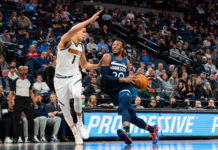 Minnesota Timberwolves guard Josh Okogie (20) dribbles in the third quarter against Denver Nuggets forward Michael Porter Jr. (1) at Target Center.