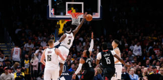 Denver Nuggets forward Torrey Craig (3) blocks the shot of Houston Rockets guard Russell Westbrook (0) as center Nikola Jokic (15) and center Clint Capela (15) and forward Michael Porter Jr. (1) watch in the second quarter at the Pepsi Center.
