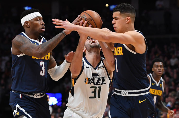 Nuggets forward Michael Porter Jr. (1) and forward Torrey Craig (3) collide into Utah Jazz forward Georges Niang (31) in the second quarter at the Pepsi Center.