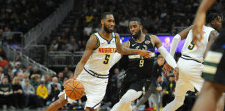 Denver Nuggets forward Will Barton (5) dribbles past Milwaukee Bucks Milwaukee Bucks guard Wesley Matthews (9) during the third quarter at Fiserv Forum.