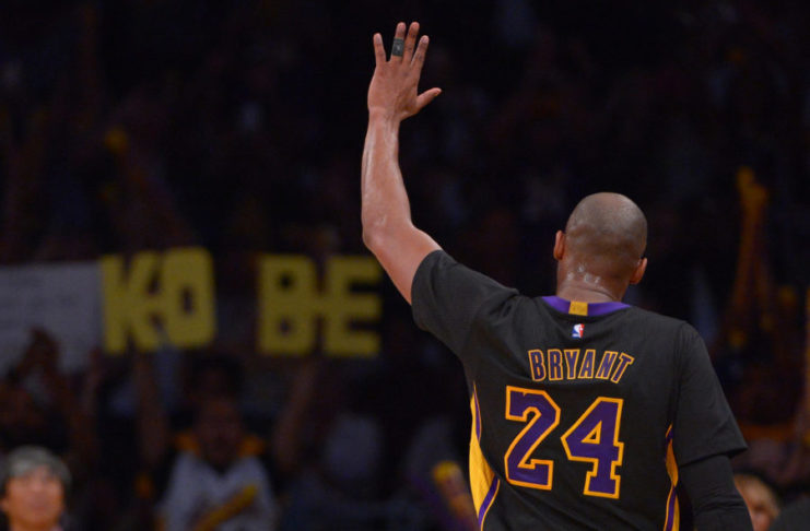 Los Angeles Lakers forward Kobe Bryant (24) waves to fans in the stands after leaving the game against the Denver Nuggets at Staples Center. The Nuggets won 116-105.