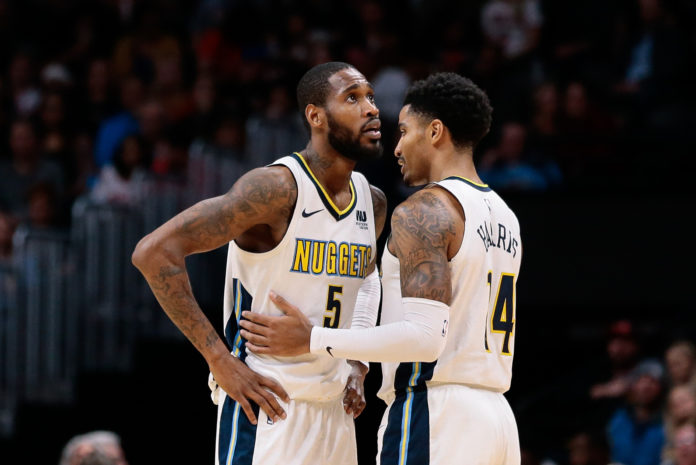 Denver Nuggets guard Will Barton (5) talks with guard Gary Harris (14) in the third quarter against the Chicago Bulls at the Pepsi Center.