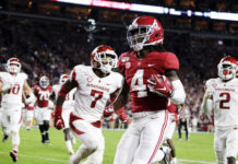 Alabama Crimson Tide wide receiver Jerry Jeudy (4) carries the ball in for a touchdown during the first half of an NCAA college football game against the Arkansas Razorbacks at Bryant-Denny Stadium.