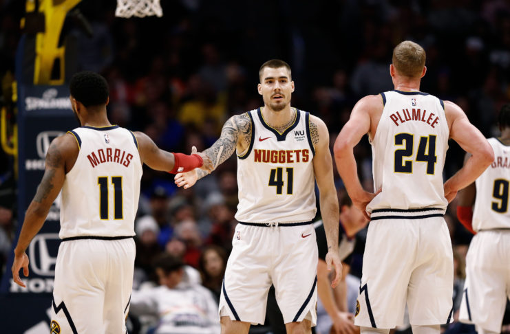 Denver Nuggets forward Juancho Hernangomez (41) reacts with guard Monte Morris (11) and forward Mason Plumlee (24) after a play in the fourth quarter against the Washington Wizards at the Pepsi Center.
