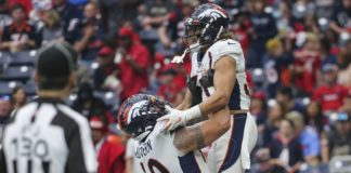 McGovern lifts Phillip Lindsay in celebration. Credit: Troy Taormina, USA TODAY Sports.