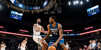 Minnesota Timberwolves forward Keita Bates-Diop (31) dribbles in the third quarter against Denver Nuggets guard Will Barton (5) at Target Center.