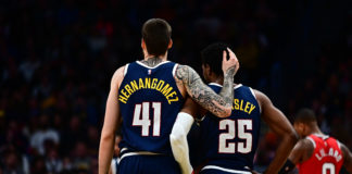 Denver Nuggets forward Juan Hernangomez (41) and guard Malik Beasley (25) embrace during the second half against the Portland Trail Blazers at Pepsi Center.
