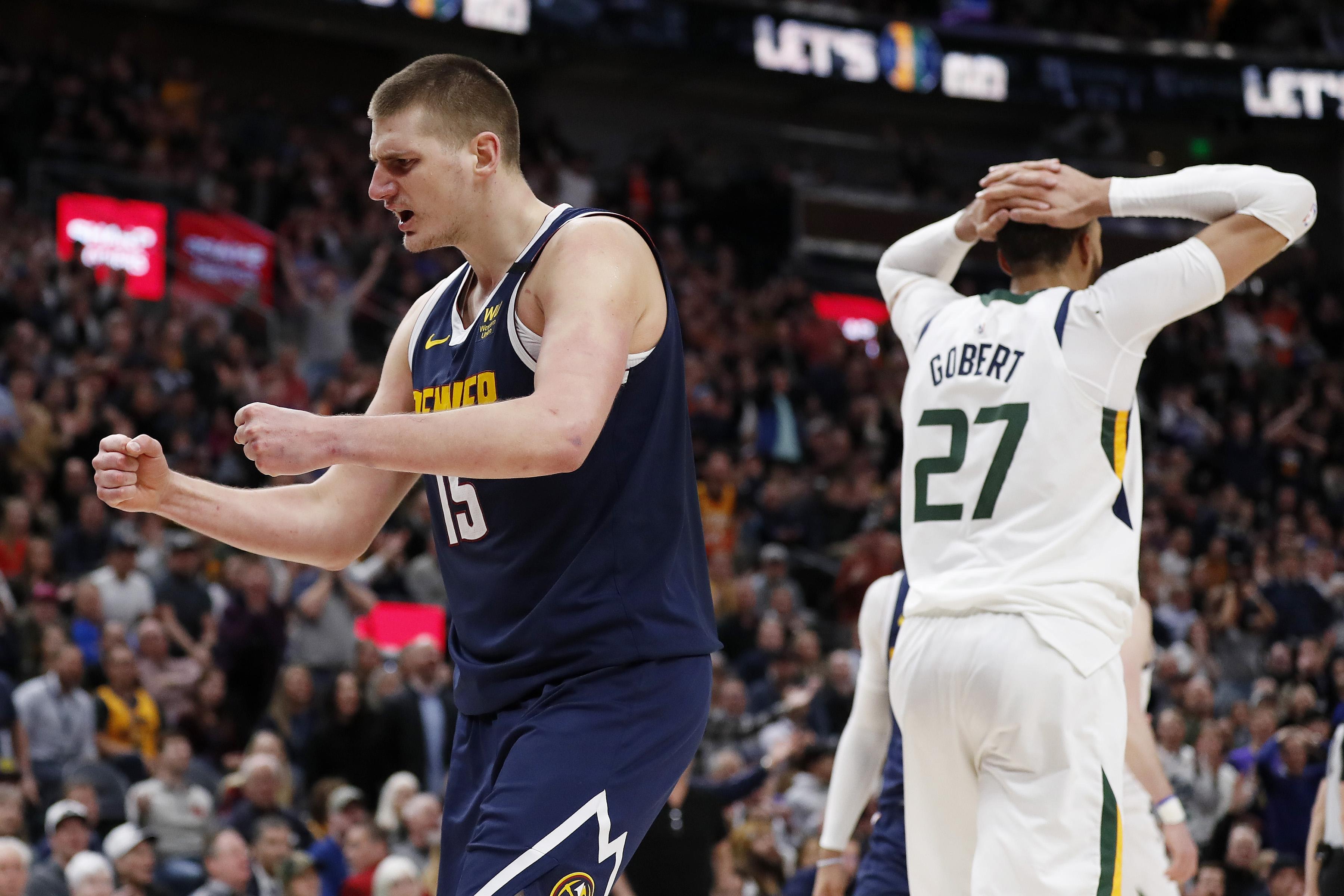 Denver Nuggets center Nikola Jokic (15) reacts after a foul against Utah Jazz guard Joe Ingles (2) (not pictured) during the fourth quarter at Vivint Smart Home Arena.