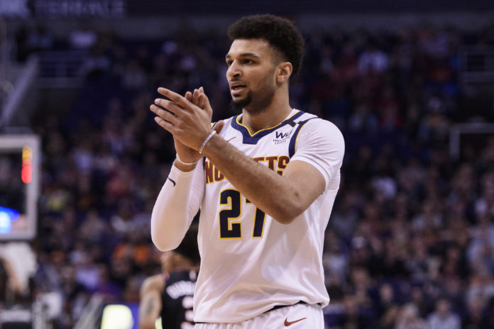 Denver Nuggets guard Jamal Murray (27) reacts in the first half against the Phoenix Suns at Talking Stick Resort Arena.