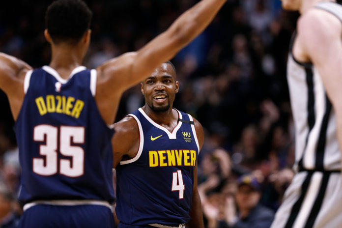 Denver Nuggets forward Paul Millsap (4) celebrates with guard PJ Dozier (35) in the fourth quarter against the San Antonio Spurs at the Pepsi Center.