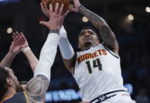 Denver Nuggets guard Gary Harris (14) drives to the goal against Oklahoma City Thunder center Steven Adams (12) during the first quarter at Chesapeake Energy Arena.