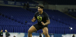Iowa Hawkeyes offensive lineman Tristan Wirfs (OL53) goes through a workout drill during the 2020 NFL Combine at Lucas Oil Stadium.
