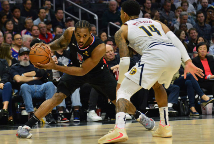os Angeles Clippers forward Kawhi Leonard (2) controls the ball against Denver Nuggets guard Gary Harris (14) during the second half at Staples Center.