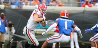 Georgia Bulldogs tight end Eli Wolf (17) runs the ball against Florida Gators defensive back CJ Henderson (1) during the first half at TIAA Bank Field.