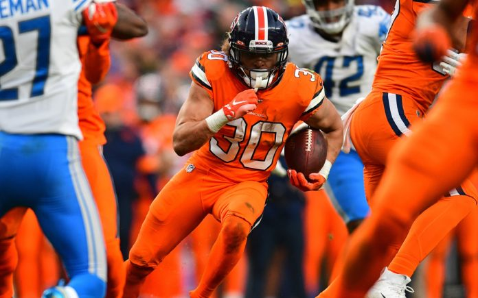 Phillip Lindsay runs between the tackles. Credit: Ron Chenoy, USA TODAY Sports.