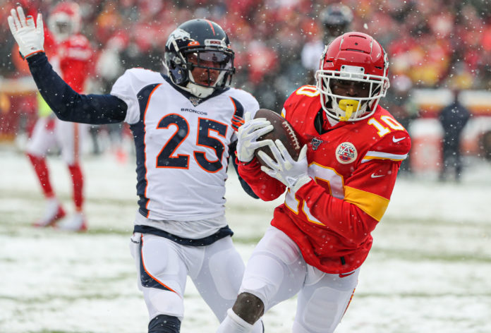 Kansas City Chiefs wide receiver Tyreek Hill (10) burns and embarrasses Denver Broncos cornerback Chris Harris (25) for a touchdown during the first half at Arrowhead Stadium.