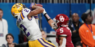 LSU Tigers wide receiver Justin Jefferson (2) catches a pass for a touchdown against Oklahoma Sooners cornerback Woodi Washington (5) during the second quarter of the 2019 Peach Bowl college football playoff semifinal game.