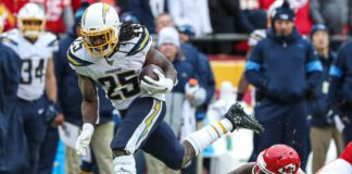 Melvin Gordon runs through a tackle. Credit: Anthony Hitchens, USA TODAY Sports.