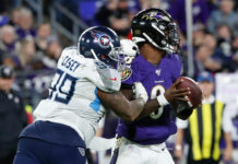 Tennessee Titans defensive end Jurrell Casey (99) causes a fumble by Baltimore Ravens quarterback Lamar Jackson (8) in a AFC Divisional Round playoff football game at M&T Bank Stadium.