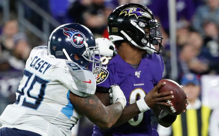 Jurrell Casey forces a sack-fumble of Lamar Jackson. Credit: Geoff Burke, USA TODAY Sports.