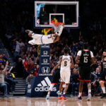 Denver Nuggets forward Torrey Craig (3) hangs off the rim after dunking the ball as forward Will Barton III (5) and Houston Rockets center Clint Capela (15) and guard Austin Rivers (25) look on in the fourth quarter at the Pepsi Center.