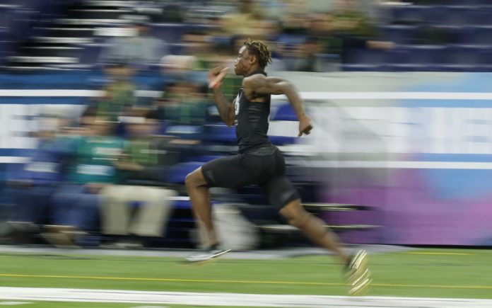 Henry Ruggs III runs the 40 at the NFL Combine. Credit: Brian Spurlock, USA TODAY Sports.