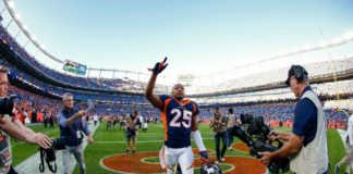 Denver Broncos cornerback Chris Harris Jr. (25) motions as he leaves the field after the game against the Tennessee Titans at Empower Field at Mile High.