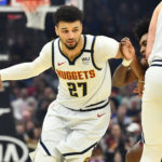 Denver Nuggets guard Jamal Murray (27) drives to the basket against as center Nikola Jokic (15) sets a screen on Cleveland Cavaliers guard Collin Sexton (2) during the first half at Rocket Mortgage FieldHouse.
