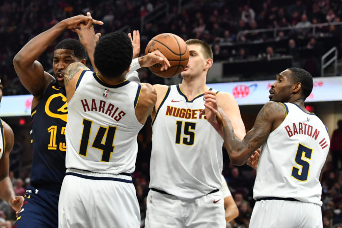 Cleveland Cavaliers center Tristan Thompson (13) and Denver Nuggets guard Gary Harris (14) and center Nikola Jokic (15) and forward Will Barton (5) battle for a rebound during the second half at Rocket Mortgage FieldHouse.