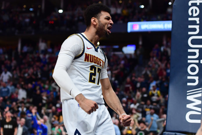 Denver Nuggets guard Jamal Murray (27) reacts following his basket in the third quarter against the Milwaukee Bucks at the Pepsi Center.