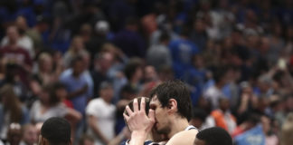 Dallas Mavericks center Boban Marjanovic (51) hugs Denver Nuggets center Nikola Jokic (15) after the game at American Airlines Center.