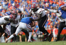 South Carolina Gamecocks defensive lineman Javon Kinlaw (3) tackles Florida Gators running back Dameon Pierce (27) during the second half at Ben Hill Griffin Stadium.