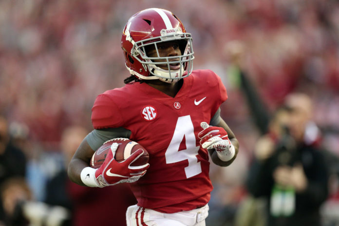 Alabama Crimson Tide wide receiver Jerry Jeudy (4) scores a touchdown against the Auburn Tigers during the second half at Bryant-Denny Stadium.