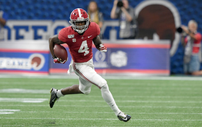 Alabama Crimson Tide wide receiver Jerry Jeudy (4) carries the ball up the field against the Duke Blue Devils during the first quarter at Mercedes-Benz Stadium.