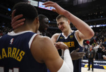 Denver Nuggets center Nikola Jokic (15), right celebrates with guard Gary Harris (14) after their win against the Utah Jazz at Vivint Smart Home Arena.