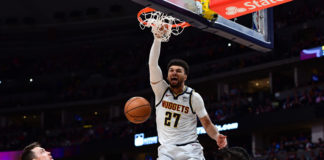 Denver Nuggets guard Jamal Murray (27) finishes off a basket over Milwaukee Bucks forward D.J. Wilson (5) in the third quarter at the Pepsi Center