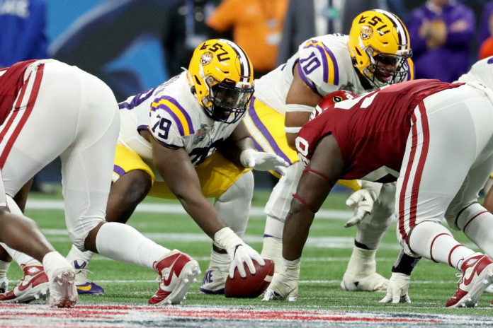 LSU Tigers center Lloyd Cushenberry III (79) prepares to hike the ball during the 2019 Peach Bowl college football playoff semifinal game against the Oklahoma Sooners at Mercedes-Benz Stadium.